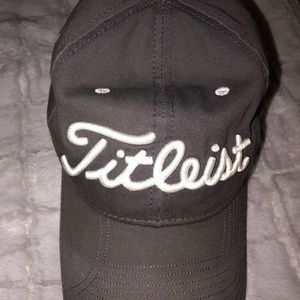 Like new titleist hat. Blue grey w/ white writing
